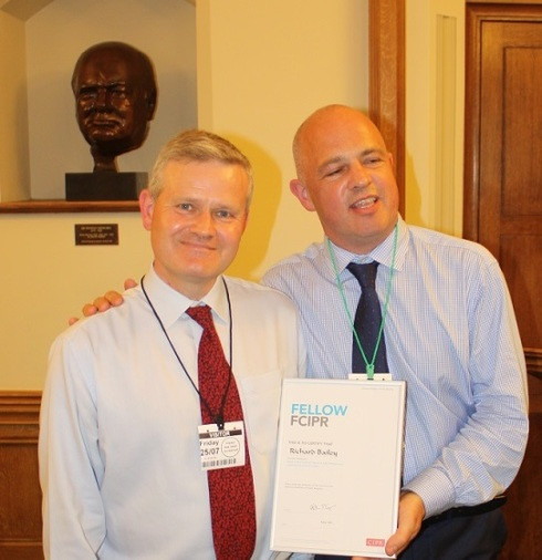 Here I am collecting my CIPR Fellowship certificate from Stephen Waddington. Winston Churchill looks on.